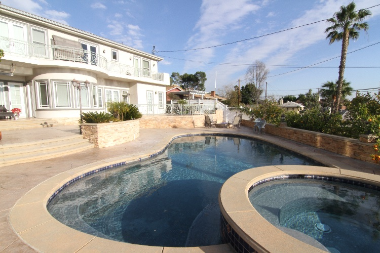 Gorgeous 2 Story Home with Huge Pool and Patio: Incredible Views of the City. Spacious Patio and Pool Area. 2 Story 3 Bedroom and 4 and a half bathroom Home. No overnight shoots allowed. Maximum crew and cast for Student Rate is 20 people, 35 for Independent, 50 for Commercial.