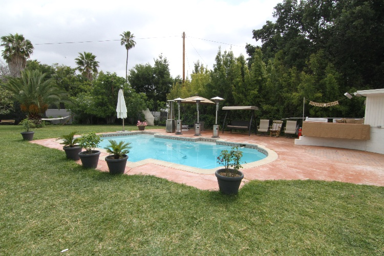 Large Backyard with Pool: Saturdays are not available for filming. Backyard with Pool, Small Kitchen, Bathroom, Hammock. Separate open space suitable for outside dining scene.