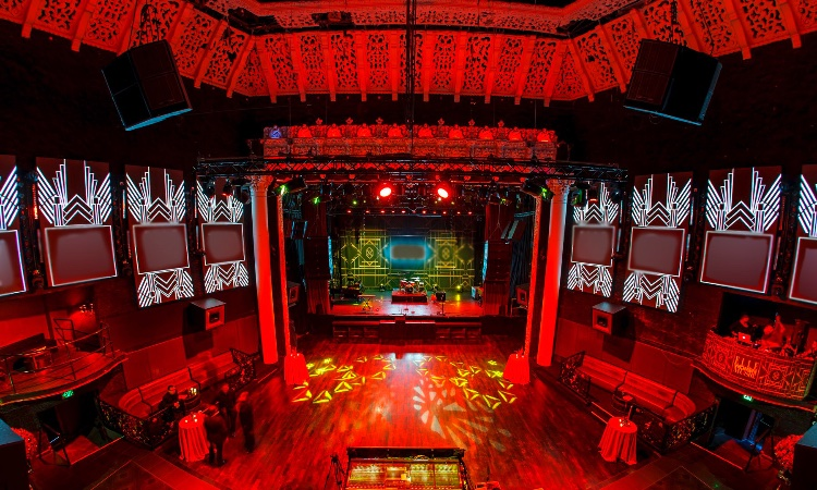Huge Club Venue with Bars and Lounges: Three Floor Club with Stage. Extra Fees: required security - $35 an hour, required production manager on site - $650 for 12 hours. Depending on what the shoot is, you will need to pay for our lighting designer, video tech (if the screens need to be on), audio tech. Business Hours: Thu (10PM-3AM), Fri (9PM-5AM), Sat (10PM-7AM). The rest of the days are available per request. Private parking is available for $20 a car for a day. Truck parking - quote case by case.