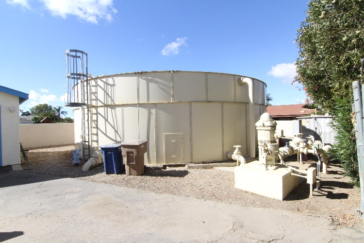 Water Company Exterior: Water tanks, rock area, small building. Two Parcels - Each about 10000 square feet.