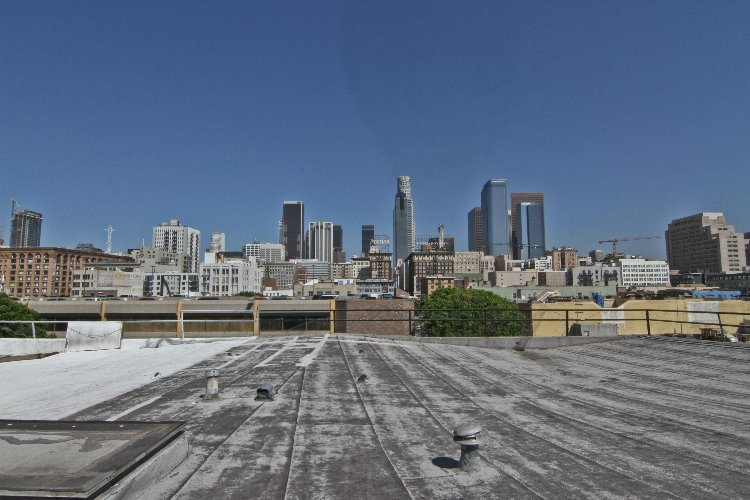 Rooftop with DTLA view: Rooftop with DTLA and City View. Room for talent and bathroom for cast and crew included. Elevator can be used to get equipment closer to the rooftop but must use stairs to move equipment up to the roof.