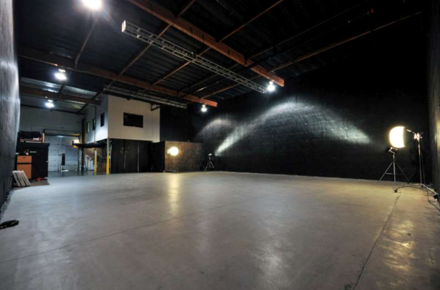 Soundstage with Roof and City View Access: Production Rental facility.  Sound proof, 20 ft. ceilings, 200 amps, stage lights, elephant doors, projector and sound system, flats for set building, 28x28 wooden dance floor, portable outside generator.  2 Floors. All rooms can be used, except office.